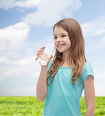 Smiling little girl with glass of water — Stock Photo