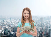 Smiling little girl with dollar cash money — Foto Stock