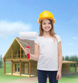 Smiling little girl in helmet with paint roller — Stock Photo