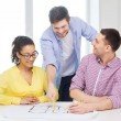 Three smiling architects working in office — Stock Photo #48951381