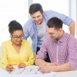 Three smiling architects working in office — Stock Photo #48951385