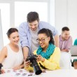 Smiling team with photocamera working in office — Stock Photo #48951683