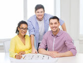 Three smiling architects working in office — Stock Photo