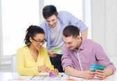Smiling interior designers working in office — Stock Photo