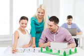Smiling architects working in office — Stock Photo