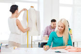 Smiling fashion designers working in office — Stok fotoğraf