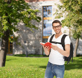 Travelling student with backpack and book — 图库照片