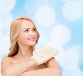 Smiling woman with exfoliation glove — Stock Photo