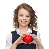 Girl with small red heart — Stockfoto