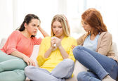 Two teenage girls comforting another after breakup — Stock Photo