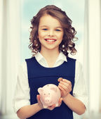 Girl with piggy bank — Stock Photo