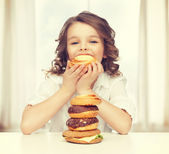 Girl with junk food — Stock Photo