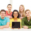 Smiling students showing tablet pc blank screen — Stock Photo #49331803