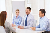 Business team interviewing applicant in office — Stock Photo