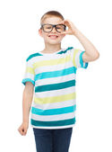 Smiling little boy in eyeglasses — Stock Photo