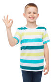 Little boy in casual clothes showing OK gesture — Stock Photo