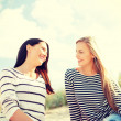 Smiling girlfriends having fun on the beach — Stock Photo #49437321