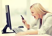 Angry woman with phone — Stock Photo