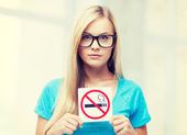 Woman with smoking restriction sign — Photo