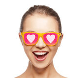 Happy teenage girl in shades with hearts — Stock Photo