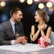 Man proposing to his girlfriend at restaurant — Stock Photo