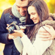 Couple with photo camera in autumn park — Stock Photo #49603283