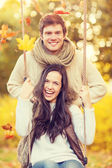 Romantic couple in the autumn park — Stok fotoğraf