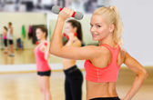 Young sporty woman with light dumbbell — 图库照片