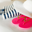 Close-up of beach bag, hat and flip-flops on bed — Stock Photo #49611435