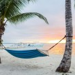 Hammock on tropical beach — Stock Photo #49611685