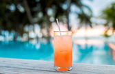 Cocktail drink on tropical beach — Stock Photo