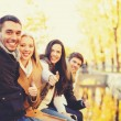 Group of friends having fun in autumn park — Stock Photo