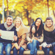 Couples with tourist map in autumn park — Stock Photo #49706461