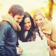 Friends with tourist map in autumn park — Stock Photo #49707039