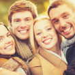 Group of friends having fun in autumn park — Stock Photo #49707725
