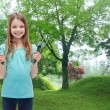 Smiling little girl with rake and scoop — Stock Photo #49712167