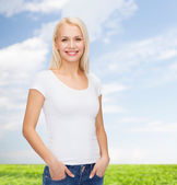 Smiling woman in blank white t-shirt — Stock Photo