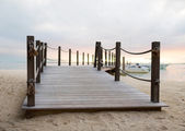 Close up of pier on tropical beach — Stock Photo