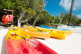 Canoes on sandy beach — Stock Photo