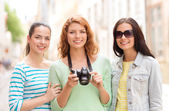 Smiling teenage girls with camera — Stock Photo