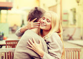 Romantic happy couple hugging in the cafe — Stock Photo