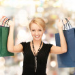 Lovely woman with shopping bags — Stock Photo #49812637
