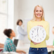 Student with wall clock — Stock Photo #49814305