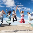 Group of teenagers jumping — Stock Photo #49814933