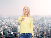 Smiling woman pointing finger at you — Stock Photo