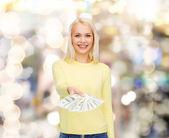 Smiling girl with dollar cash money — Stok fotoğraf