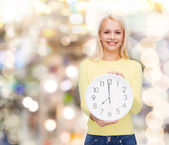 Student with wall clock — Stock Photo