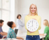 Student with wall clock — Stok fotoğraf