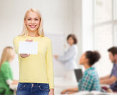 Smiling girl with blank business or name card — Stock Photo