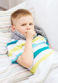 Ill boy with flu at home — Foto Stock